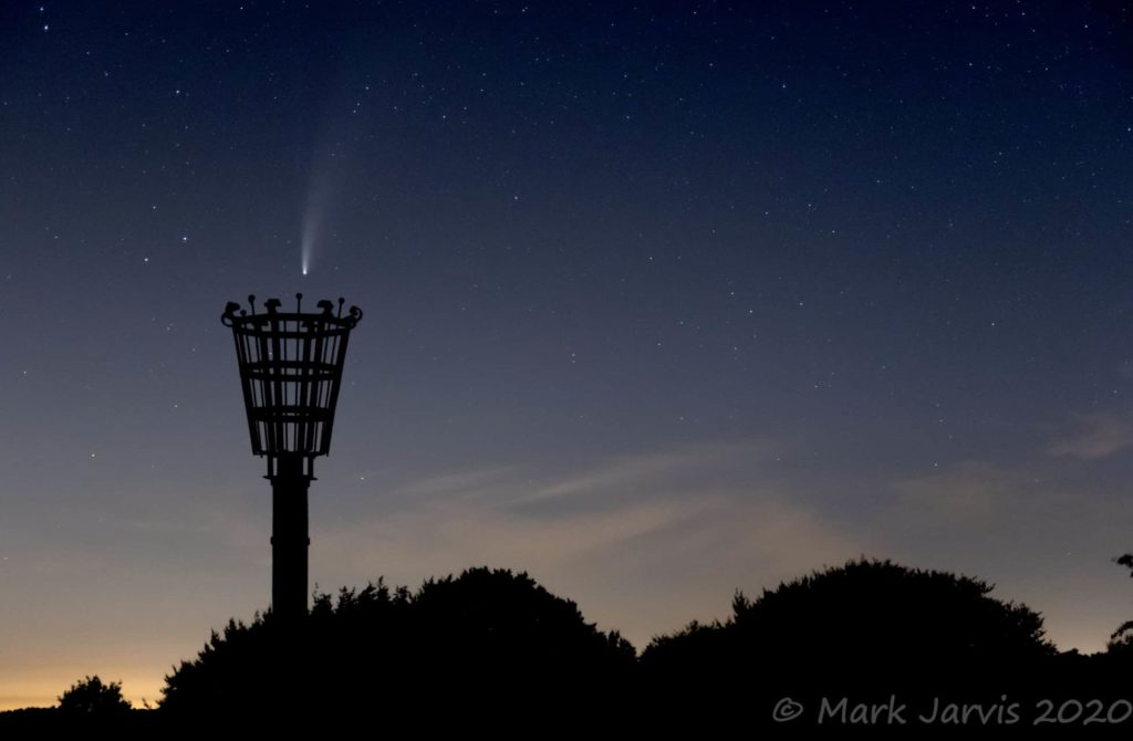 Photo showing comet in sky above the beacon